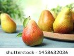 Ripe Juicy Pears On Blue Woode...