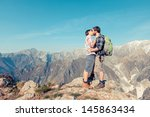 couple kissing at top of...   Shutterstock . vector #145863434
