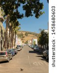 Small photo of Street with palmy and many colorful houses in the Bo Kaap district in Cape Town, South Africa.