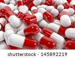 red and white pill capsules pile | Shutterstock . vector #145892219