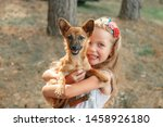 Stock photo kids play with cute little puppy children and baby dogs playing in sunny summer garden little 1458926180