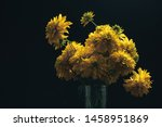 Yellow Flowers In Vase On A...