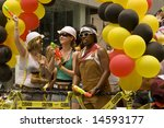 NEW YORK - JUNE 29: Parade-goers participate in the Pride Parade June 29, 2008 in New York City. - stock photo