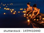 Stock photo young asian girls floating lanterns in the lake the festival may originate from an ancient ritual 1459410440