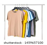 Stock photo rack with hanging clothes on white background 1459657100