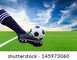 foot kicking soccer ball | Shutterstock . vector #145973060