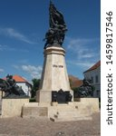 Small photo of Word war I. monument in Hungary.The monument consists of three groups of statues.Two groups of pages depict the theme of combat and glorification.Each with a soldier and a lion as a symbol of heroism.
