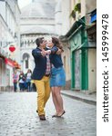 couple dancing on montmartre | Shutterstock . vector #145999478