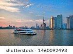 Small photo of Shanghai, Chgina -- May 31, 2019. Sightseeing tour boat traverses Shanghai's scenic Huangpu River at dusk.