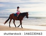 Kids Riding Horse On Beach....