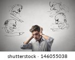 Small photo of young man covers his ears with his hands