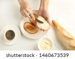 Woman Spreading Tasty Butter...