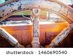 Old Wooden Ship's Wheel And...