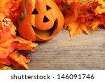Smiling Pumpkin Head On Wooden...