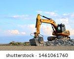 Excavator With Crusher Bucket...