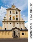 Old Dominican Monastery , church of St. Josaphat on cloudy sky background, main entrance, facade elements. Ancient historical city  Zhovkva,  Lviv region, western Ukraine. Tourism destination, torist