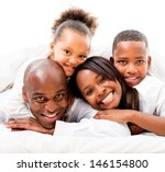 cute family lying in bed  ... | Shutterstock . vector #146154800