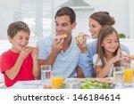 Happy Family Eating Pizza...