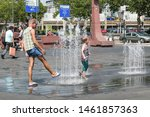 Man Cools Down In The Fountain. ...