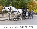 Horse Carriage with old fashioned dressed couple in love - stock photo