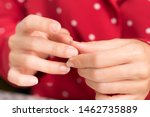 Small photo of Closeup: Female's fingernails which is thin weak and cracked, it's damaged from chemical in manicure products and lack of Vitamins, Iron, Calcium. Beauty Fingernails problem and treatment concept.