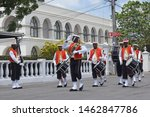 Small photo of Bridgetown, Saint Michael, Barbados. March 22, 2018. Changing of the guard outside historic garrison. Sargeant major gives salute with drummers in background. Arches of former British garrison visible