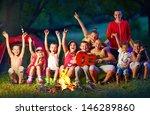 happy kids singing songs around ... | Shutterstock . vector #146289860