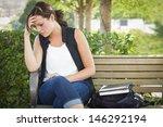 Upset Young Woman Sitting Alon...