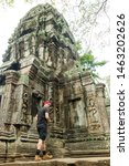Small photo of Siem Reap, Cambodia - 29 May 2019 : a tourist is posing in Angkor Wat, Siem Reap, Cambodia