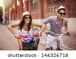 Couple Riding Bicycles In The...