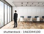 businessman looking out window... | Shutterstock . vector #1463344100
