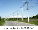row of wire pole inside road on ... | Shutterstock . vector #146343860