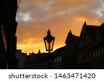 Traditional vintage street lamp and architecture of Prague in the evening