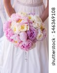 Bride Holding A Bouquet With...