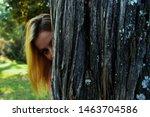 girls behind tree playing hide... | Shutterstock . vector #1463704586