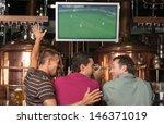 happy soccer fans. three happy... | Shutterstock . vector #146371019