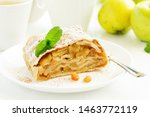 Small photo of apple strudel with cinnamon and an ice cream ball.