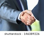 handshake in office | Shutterstock . vector #146389226