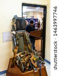 Small photo of Vasco da Gama, Goa, India - 03/09/2019: close up of fighter jet aircraft green ejection seat, belts, launching mechanism for safe evacuation of a pilot in case of emergency at Naval Aviation Museum
