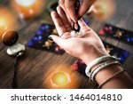 Small photo of Fortune teller reading fortune lines on hand Palmistry Psychic readings and clairvoyance hands concept with Tarot cards divination / Palm reading Magic Spiritual and Horoscopes Occult