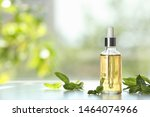 Bottle Of Mint Essential Oil On ...