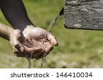 Thirsty Hands Taking Water Fro...