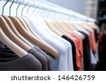clothes hang on a shelf in a... | Shutterstock . vector #146426759