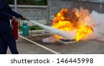 fighting fire during training | Shutterstock . vector #146445998