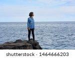 Woman On A Rock Looks Towards...