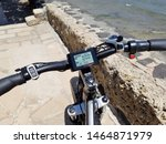 Small photo of Honolulu - June 9, 2018: Rad Power Bikes Display screen, front tire, and handle bars . The LCD Display information categories. A Seattle ebike company, Rad Power Bikes is a consumer direct ebike.