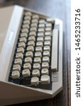 """Small photo of Close up of the keyboard of an old typewriter. The keyboard is set in AZERTY and is an old French one, as evidenced by the omission of the """"1"""" key in favour of the """"Fr"""" (francs) one."""