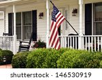 Front Porch Of White Colonial...