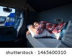 Truck Driver Sleeping In His...
