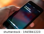 """Small photo of Bangkok, Thailand - July 30, 2019 : Siri, Apple's voice-activated digital assistant, tells iPhone user to ask her by showing the text """"Go ahead, I'm listening"""" on the display."""